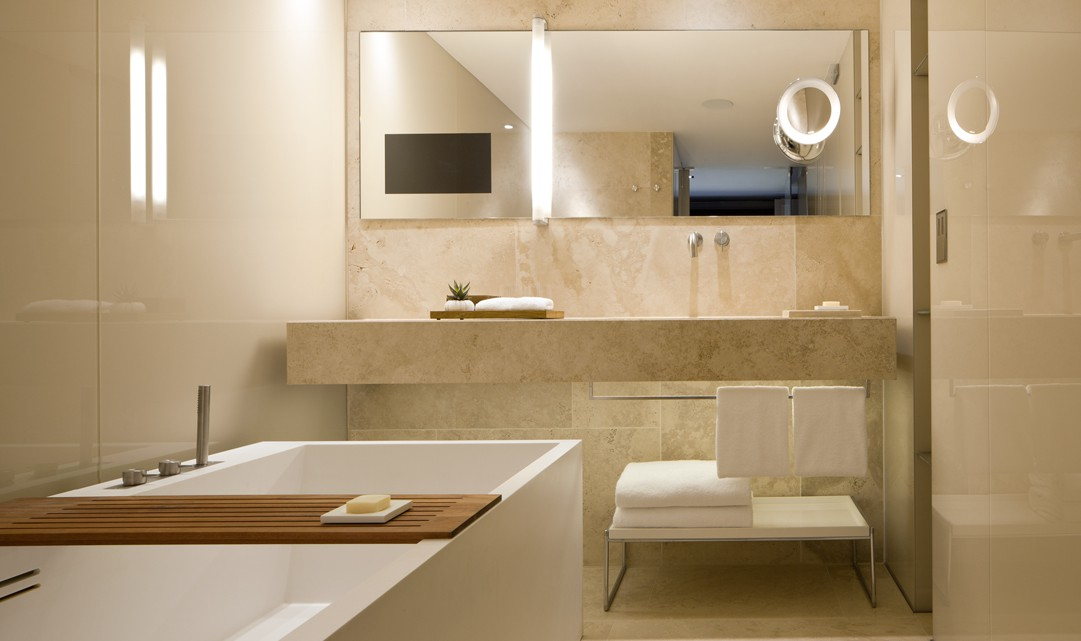 A beige marble bathroom, designed with clean, contemporary lines