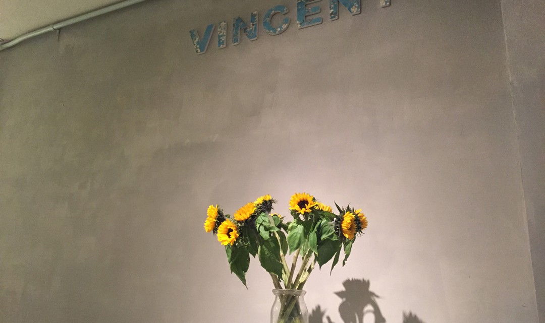 "Vase with sunflowers on a ""Vincent"" sign"