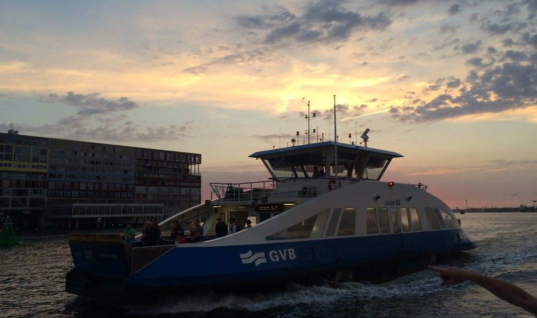 Ferry on the river IJ at sunset