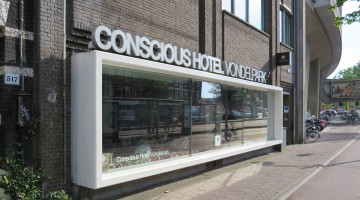 A large boxed window with the Conscious Hotel Vondelpark logo above it