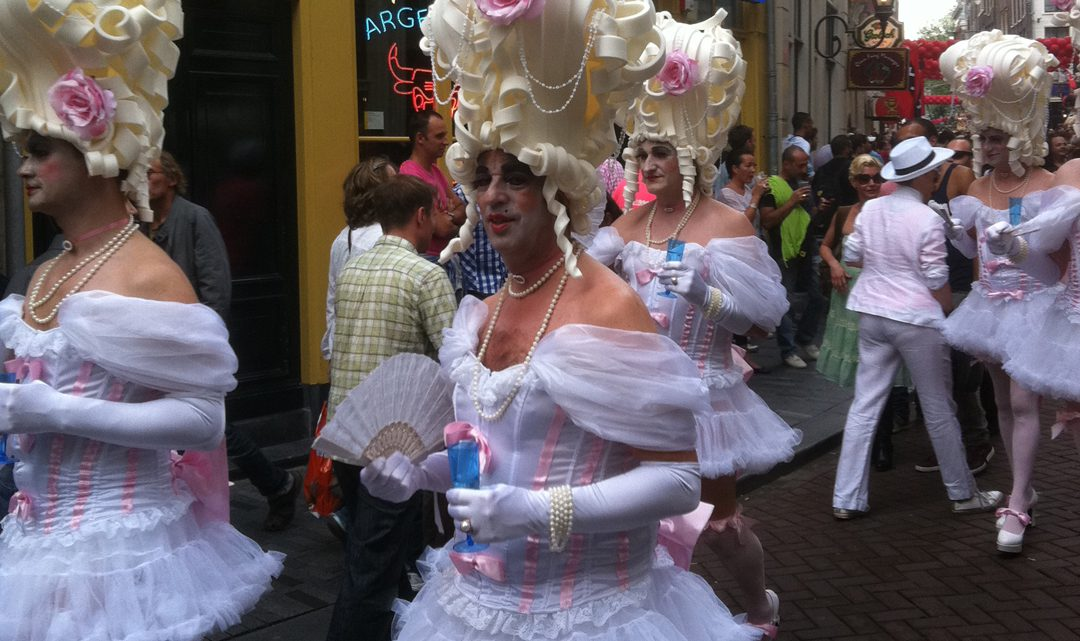 A group of elaborately dressed drag queens