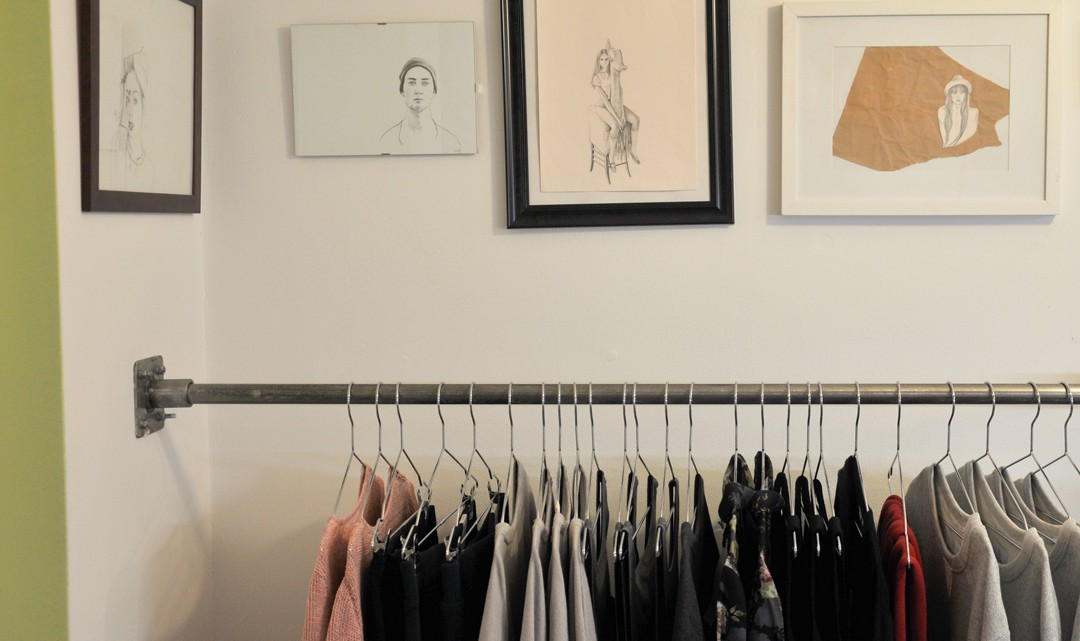 Sketches above clothing rack
