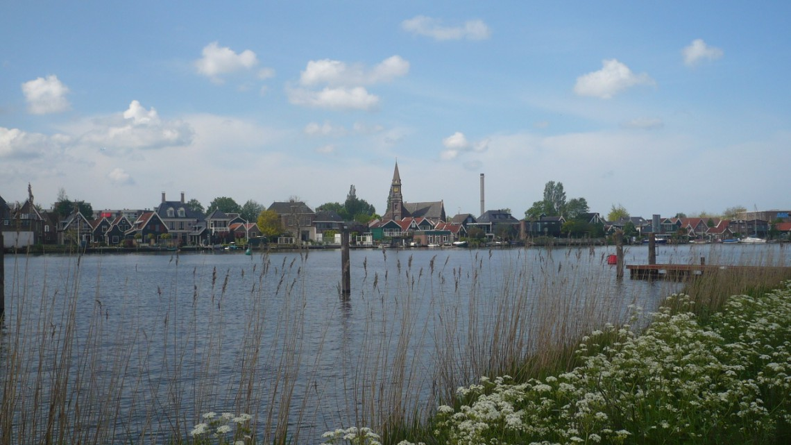 A view over the water towards a little village