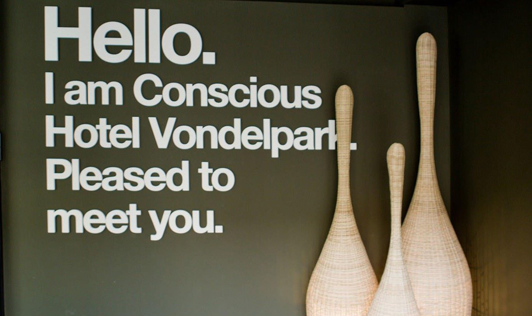 "The Welcome sign at the entrance saying: ""Hello I am Conscious Hotel Vondelpark. Pleased to meet you."""