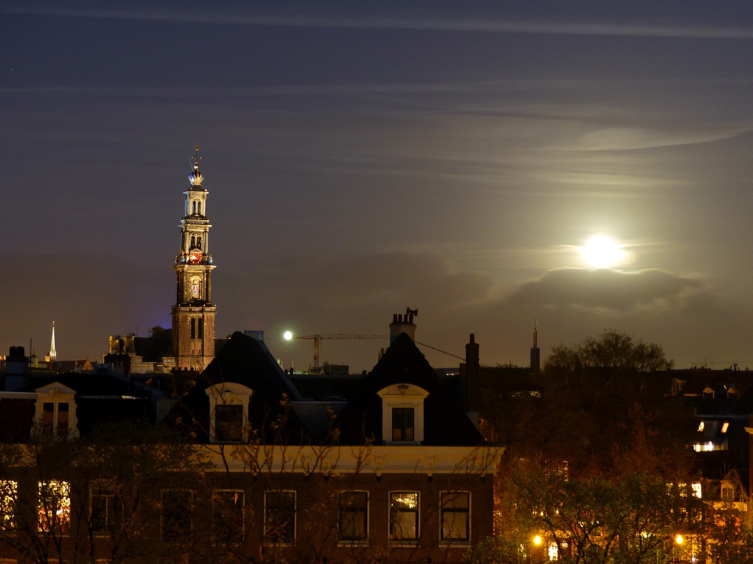 ... Western Tower as viewed from a distance and the full moon next to it