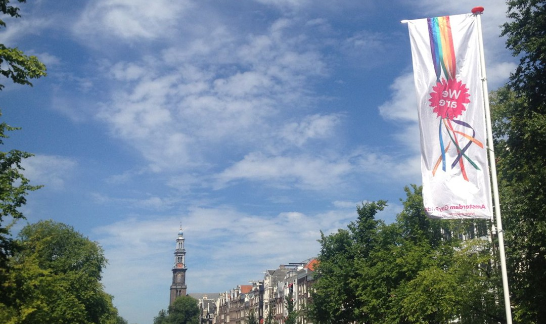 We are proud flag with Westertoren in the background