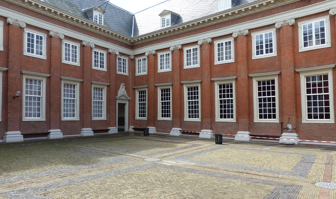 The paved courtyard with two sides of the museum's historic building