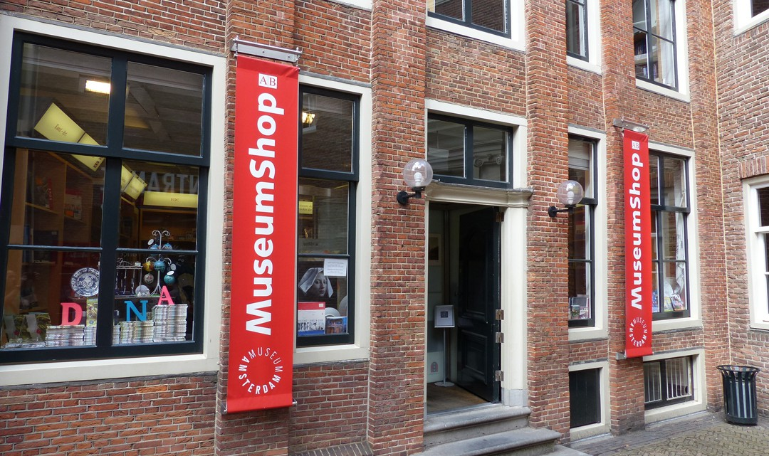 The entrance to the museum shop with banners on the side of the door