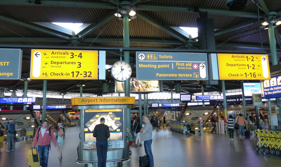 Clear yellow and grey signage boards in the central arrivals hall