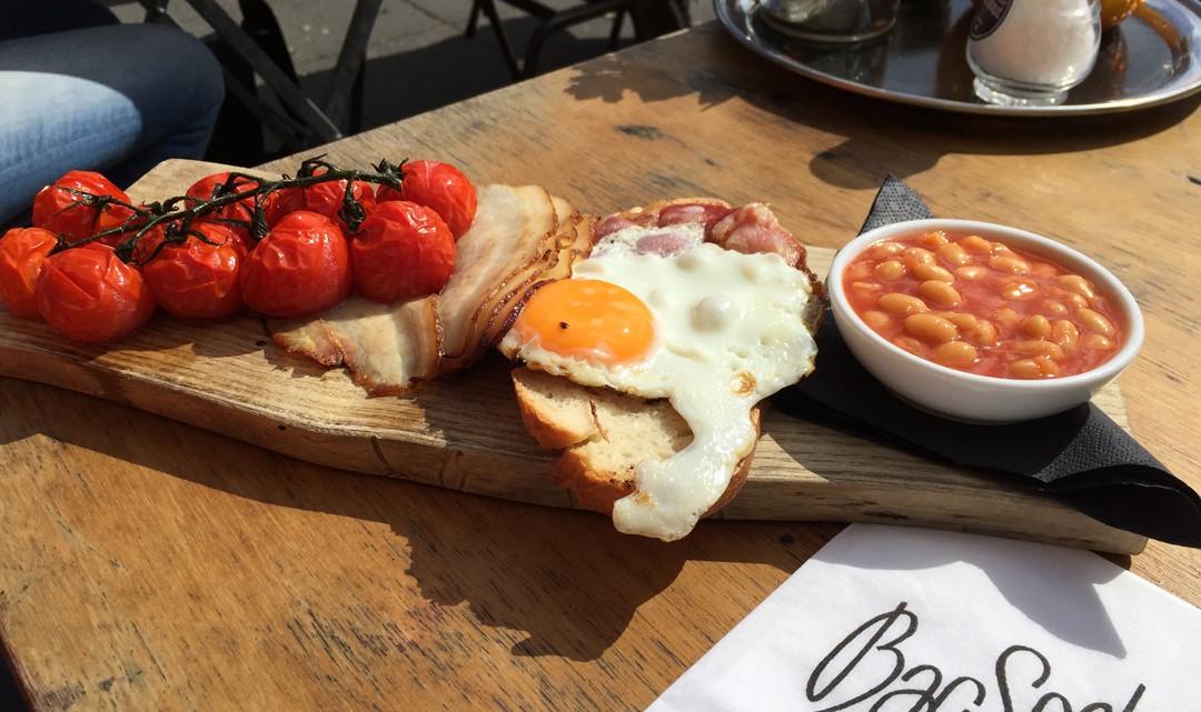 Full English breakfast on flat wooden plate