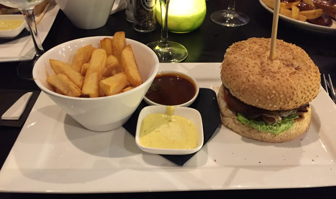 A plate with the delicious burger