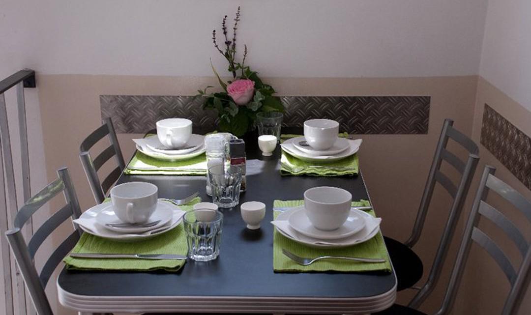 A neatly set breakfast table