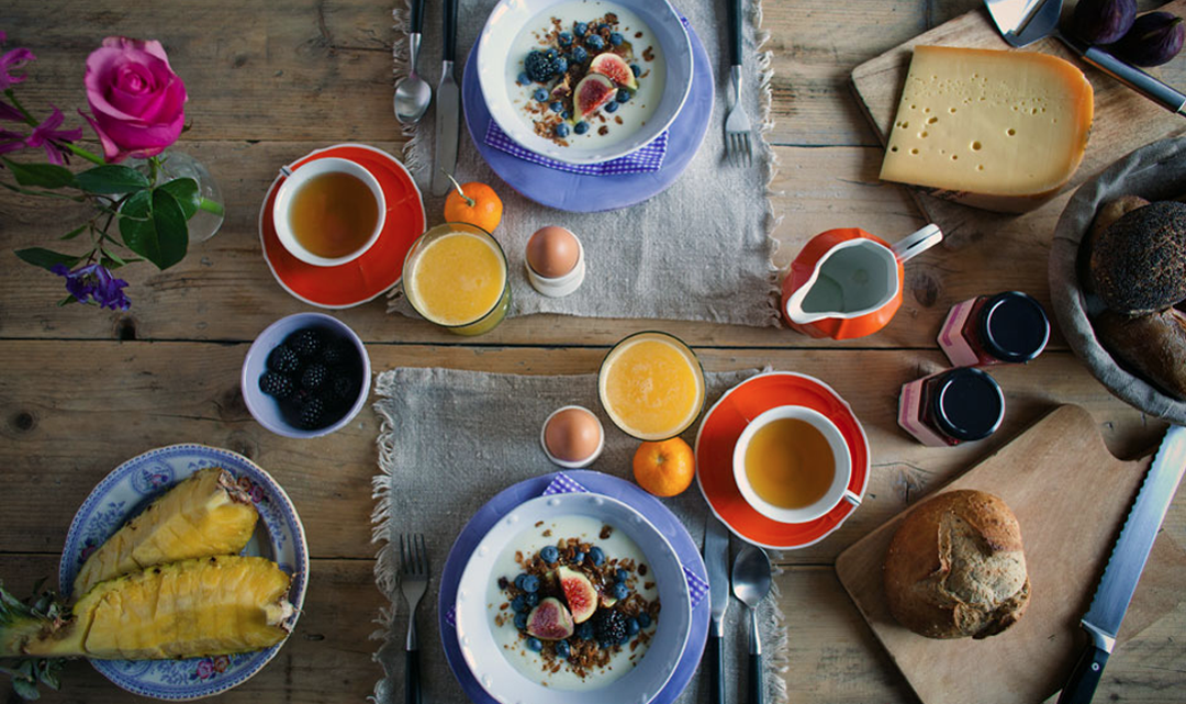 A set breakfast table from above with delicious food