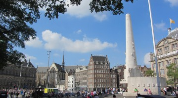 View over Dam Square, with the National war memorial in the foreground and the New Church and Royal Palace in the background
