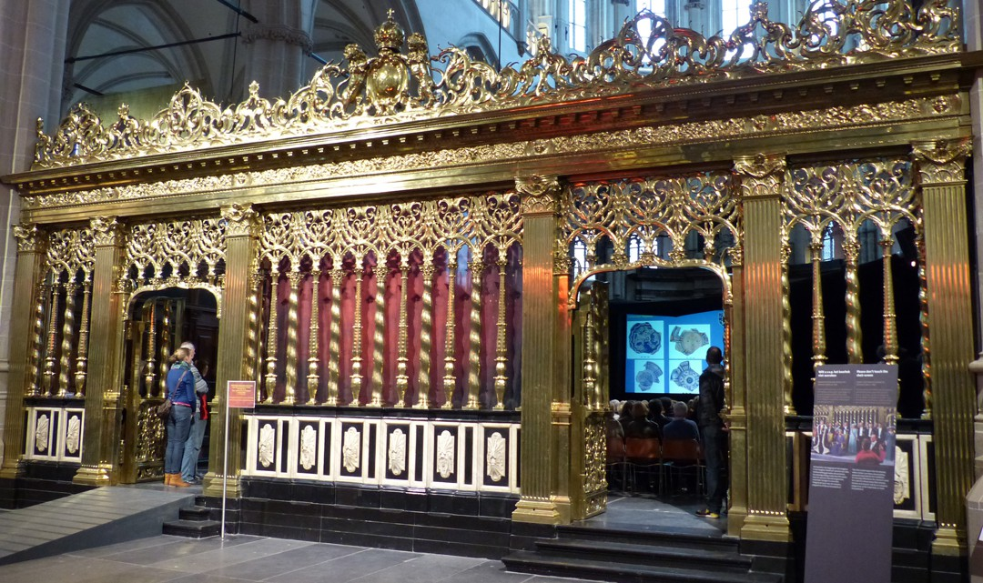 A richly decorated, golden choir screen of the New Church