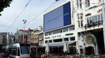 The building with a large LED screen on the gable