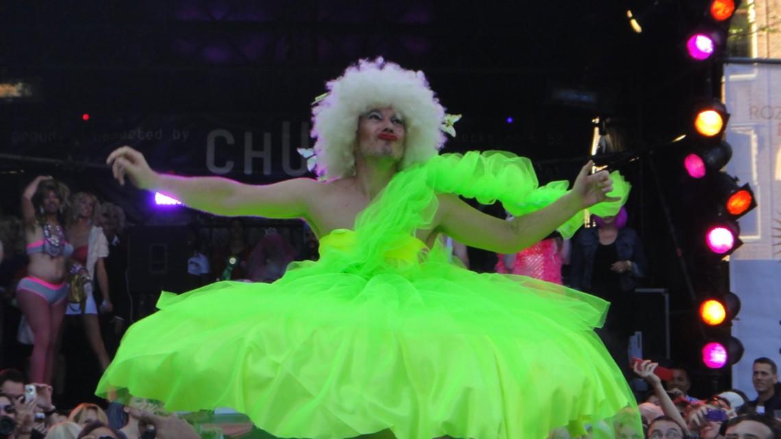 Fluorescent drag queen at the handbag toss