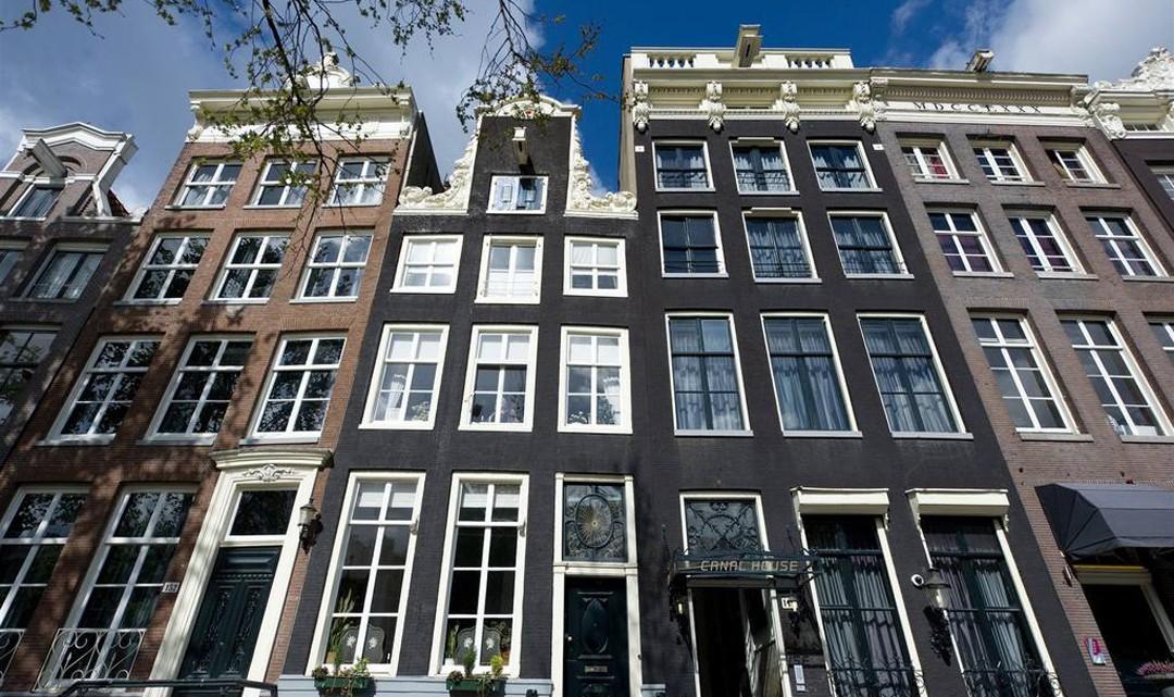Amsterdam canal house gables against a blue sky