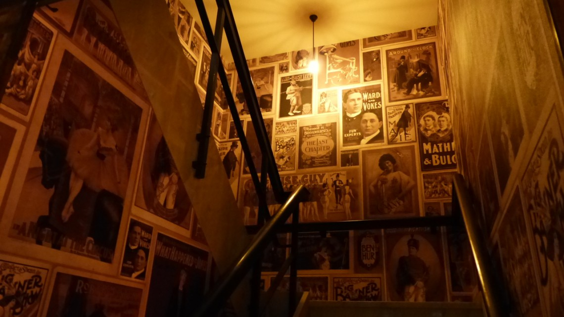 A basic stairs made special by using hundreds of theater posters as wall paper