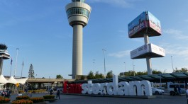 Iamsterdam sign in front of Schiphol air traffic control tower