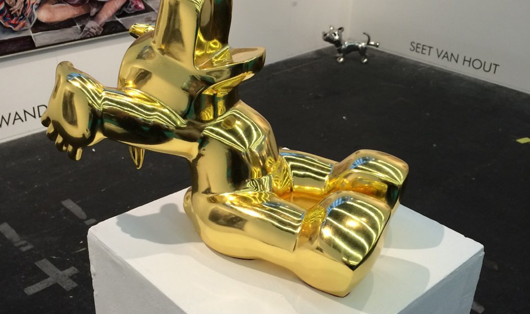 Happy - statue of a gold dog