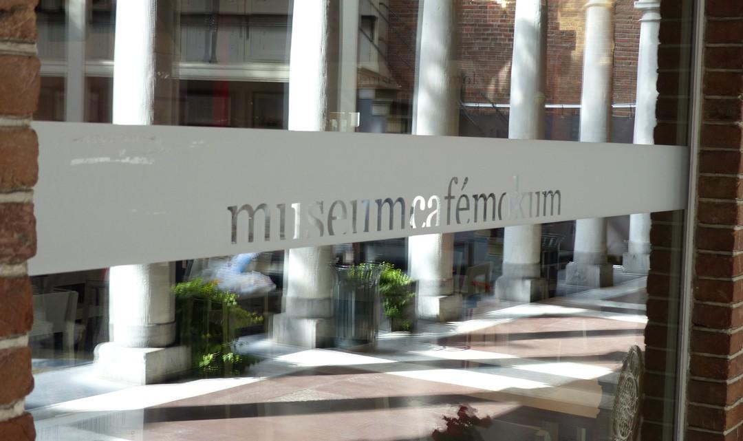 The text Museum Café Mokum on a partly sandblasted window