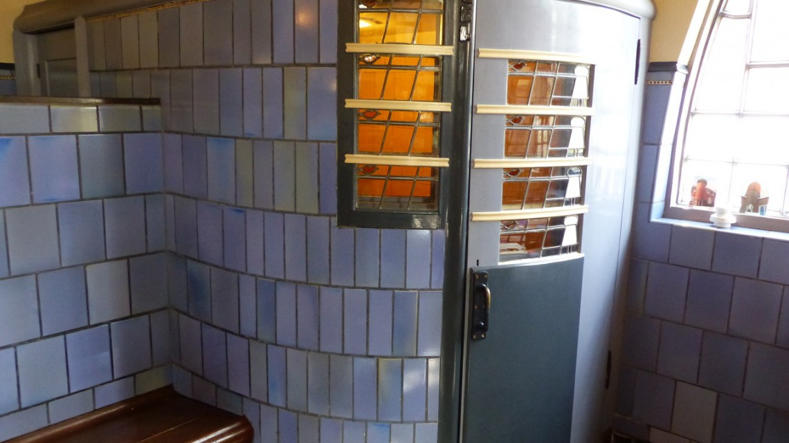 The telephone booth with blueish glazed tiles in the old post office