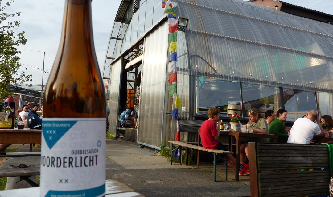 Noorderlicht beer bottle and the building in the background