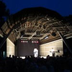 View on the stage where there is a tango performance of a man and a woman
