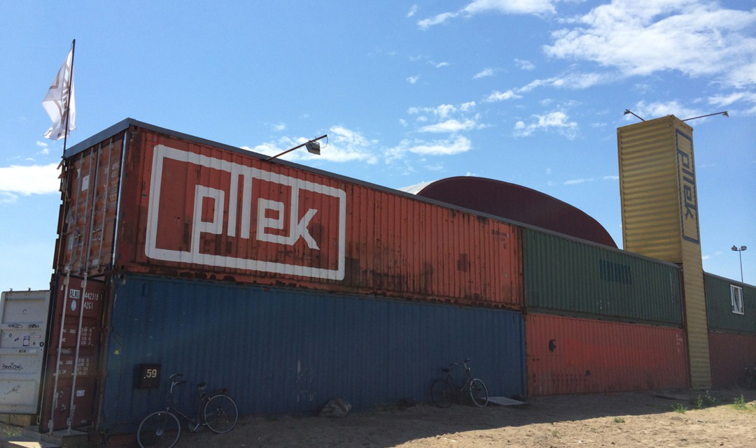 Pllek logo on the back of the containers