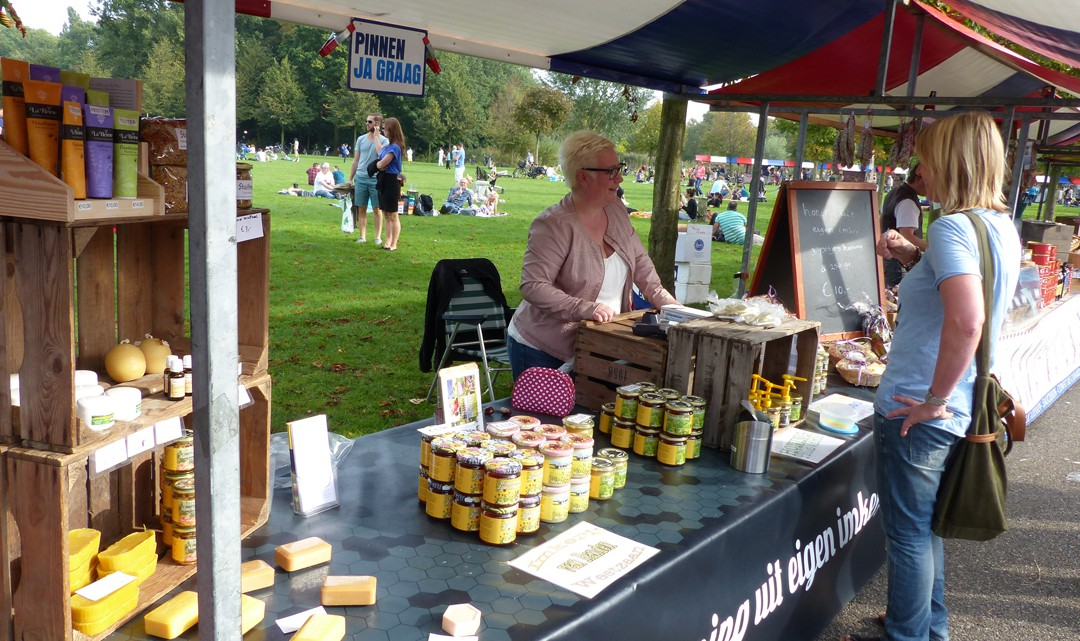 A market stall with stacks of honey pots , honey soaps and other products made from honey