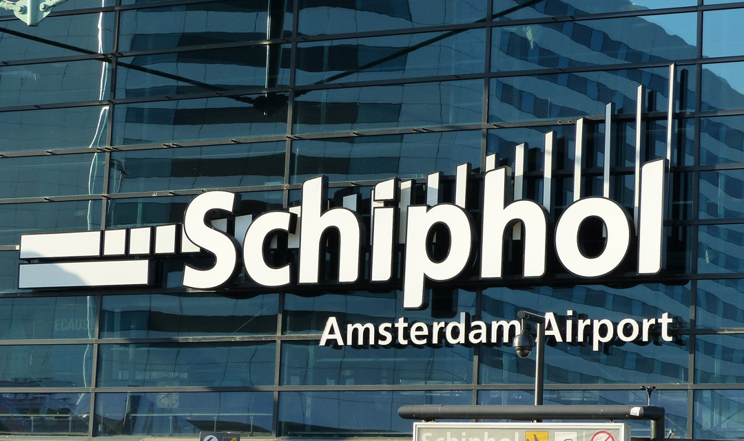Schiphol Amsterdam Airport logo on the terminal building