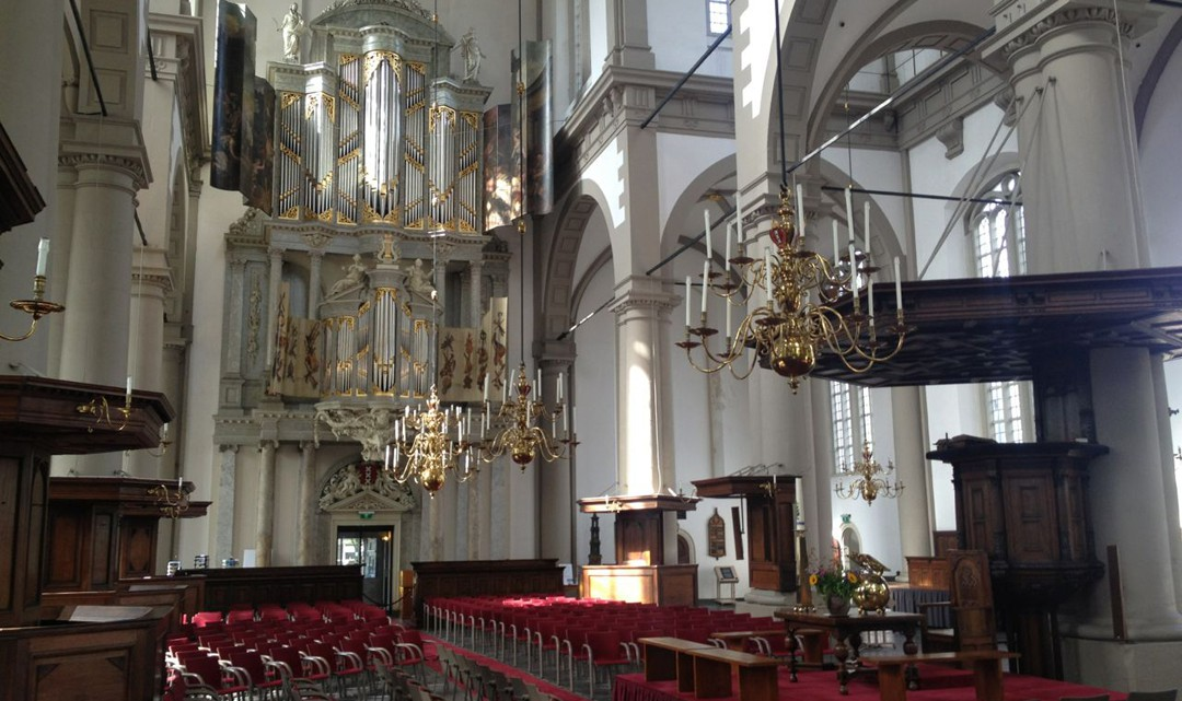 The organ and pulpit in the sober interior