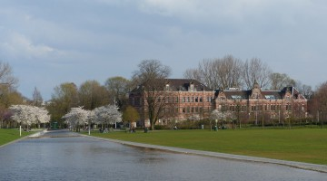Water, blossoming trees and a historic building
