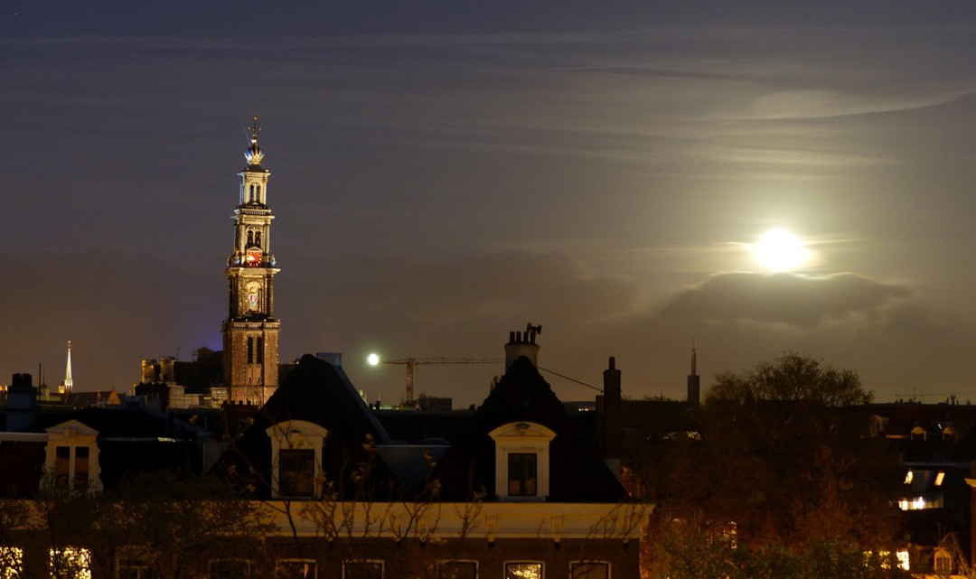 The Western Tower as viewed from a distance and the full moon next to it