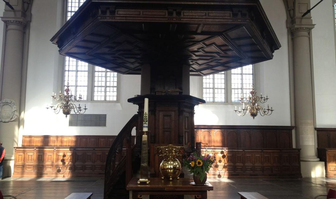 The dark wooden pulpit
