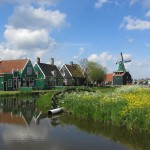 A view over the water towards the typical Zaanse houses and a windmill