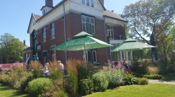 't Huis aan de Amstel and garden bathing in sunlight